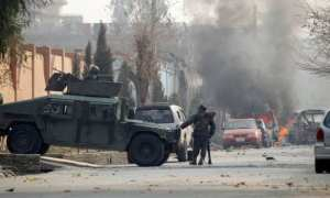 A suicide attacker detonates a bomb at the gates of the charity save the children compound in Jalalabad, in Afghanistan