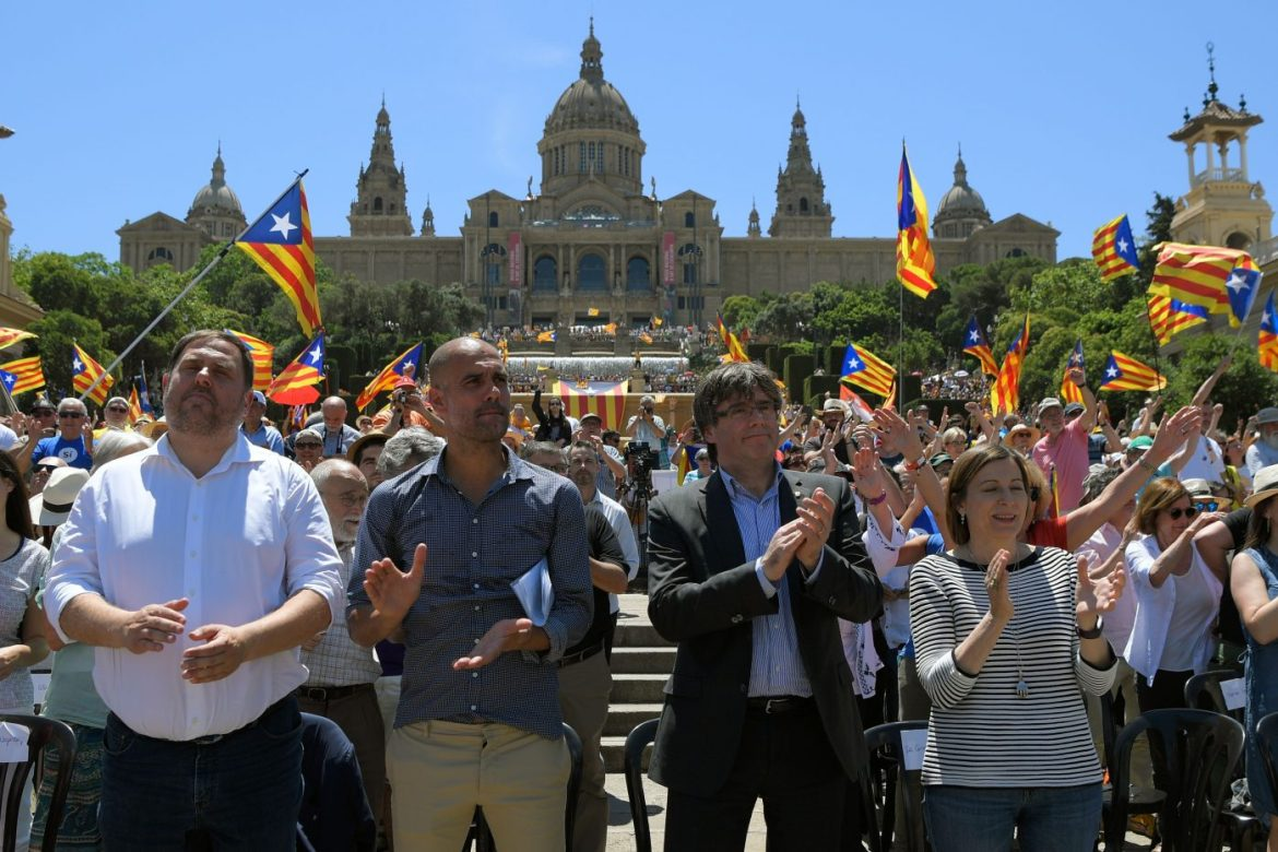 Pep Guardiola and Carles Puigdemont celebrating the independence of the Catalans