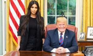 Kardashian West, who wore a black suit with bright yellow stilettos, was spotted leaving the White House with a small entourage about an hour after she arrived