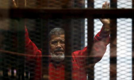 Former Egyptian president Mohamed Morsi died on Monday after he collapsed in his cage after speaking in court