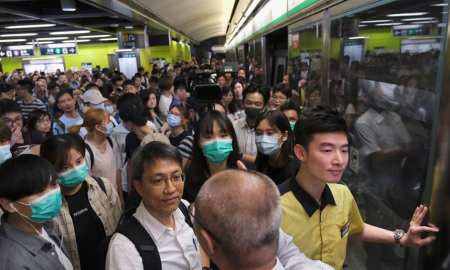 Hong Kong protesters disrupt commuters and delay employees getting to work