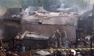 Breaking News: Pakistani military aircraft on a training flight crashed in a built-up area in the city of Rawalpindi, killing all five crew members and 12 civilians