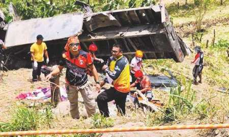 Rescue workers try to save as many lives in T'Boli town in South Cotabato province,in the southern island of Mindanao, Philippines