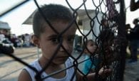 Greek police fire tear gas at migrant children