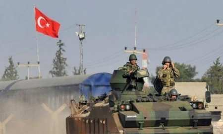 Turkey dismisses US threats, amasses troops on Syrian border