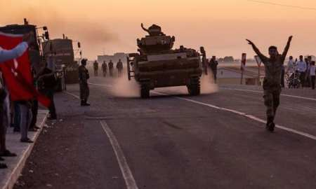 Turkey agrees to suspend Syria offensive while Kurds withdraw