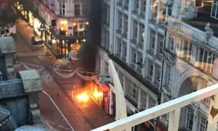 Part of a busy city centre street has been cordoned off after an underground fire reached above the surface in big flashes of flame.