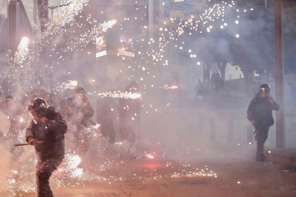 Lebanon's protest movement took a violent turn on Saturday night as security forces cracked down on demonstrators in central Beirut, firing tear gas and rubber bullets and wounding dozens.