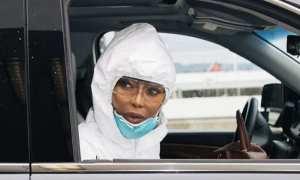 Naomi Campbell hazmat suit