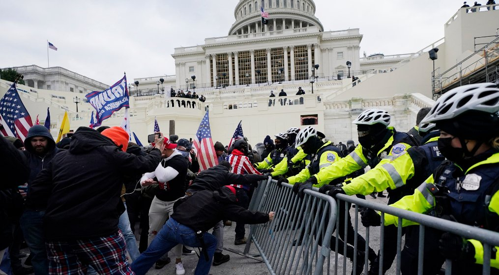 Armed standoff capitol and the US congress reconvenes to certify Biden's win in the US Capitol