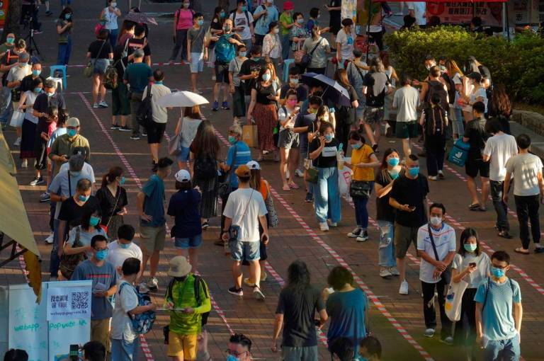 Dozens of Hong Kong pro-democracy figures arrested under national security law