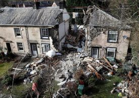 House explosion kills a 79-year-old woman and leaves two injured