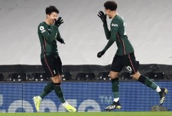 Dele Alli and Heung-Min Son celebrate Tottenham's only goal of their Premier League fixture against Fulham