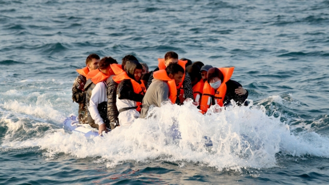UK and France strike deal to tackle migrant Channel crossings with increased beach patrols