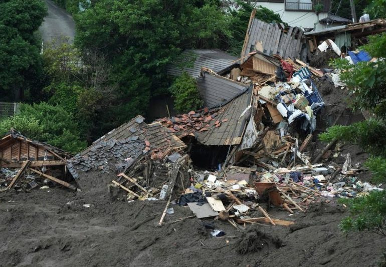 Rescuers sift through debris to find dozens in landslide-hit Japan town