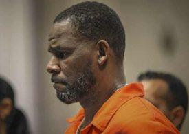 R Kelly sexually abused teenage boy as well as girls, say federal prosecutors