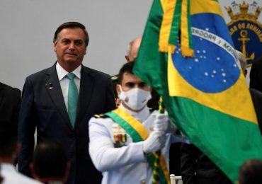 Pro-Bolsonaro protesters break down Brasilia police blockade