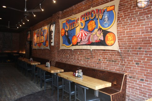 New booths and tables were added to dining areas, along with vibrant wall art.