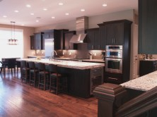 Contemporary walnut kitchen cabinets with granite countertop island WunderWoods