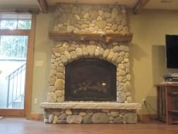 WunderWoods natural live edge cedar log wood mantel stone fireplace
