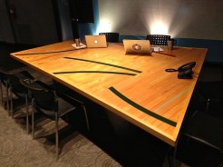 WunderWoods reclaimed basketball gym floor conference table top in room