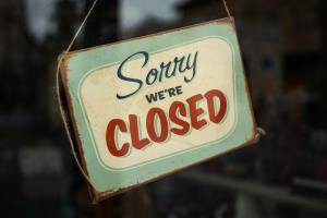 """Sign reading """"Sorry we're closed"""""""