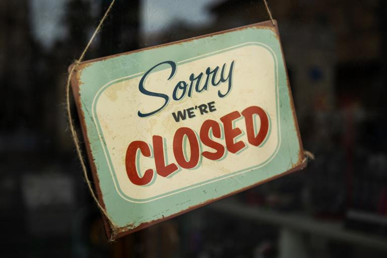"Sign reading ""Sorry we're closed"""