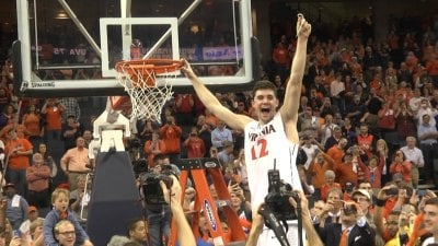Joe Harris celebrates winning the ACC regular season championship in 2014