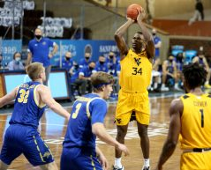 SIOUX FALLS, SD - NOVEMBER 25: Oscar Tshiebwe #34 of the West Virginia Mountaineers shoots a jumper against the South Dakota State Jackrabbits during the Bad Boy Mowers Crossover Classic at the Sanford Pentagon in Sioux Falls, SD. (Photo by Dave Eggen/Inertia)