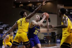 SIOUX FALLS, SD - NOVEMBER 25: Matt Dentlinger #32 of the South Dakota State Jackrabbits drives past Derek Culver #1 of the West Virginia Mountaineers during the Bad Boy Mowers Crossover Classic at the Sanford Pentagon in Sioux Falls, SD. (Photo by Richard Carlson/Inertia)