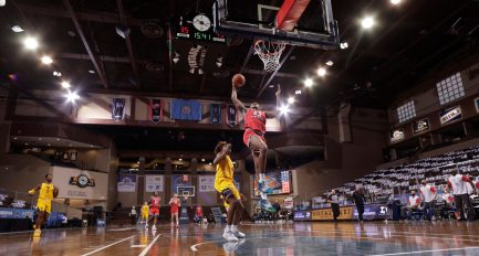 SIOUX FALLS, SD - NOVEMBER 27: Charles Bassey #23 of the Western Kentucky Hilltoppers takes off for a dunk against the West Virginia Mountaineers during the Bad Boy Mowers Crossover Classic at the Sanford Pentagon in Sioux Falls, SD. (Photo by Richard Carlson/Inertia)