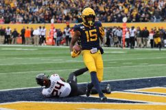 Wide receiver George Campbell (15) scores a Mountaineer touchdown.