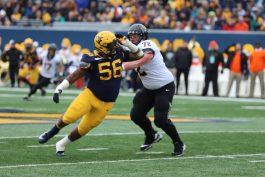 Junior Darius Stills (56) goes to rush the quarterback.