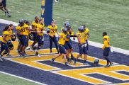 April 24, 2021; Morgantown, West Virginia, USA; Players celebrate with West Virginia Mountaineers defensive lineman Brayden Dudley (97) at the end of the Spring Game at Mountaineer Field at Milan Puskar Stadium. Mandatory Credit: Ben Queen