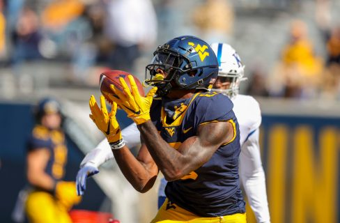 Oct 17, 2020; Morgantown, West Virginia, USA; West Virginia Mountaineers wide receiver Bryce Ford-Wheaton (0) catches a touchdown pass during the first quarter against the Kansas Jayhawks at Mountaineer Field at Milan Puskar Stadium. Mandatory Credit: Ben Queen-USA TODAY Sports