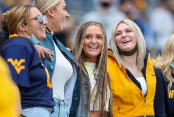 """April 24, 2021; Morgantown, West Virginia, USA; West Virginia Mountaineers fans sing """"Country Roads"""" at the end of the Spring Game at Mountaineer Field at Milan Puskar Stadium. Mandatory Credit: Ben Queen"""