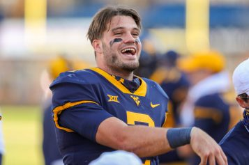 Oct 17, 2020; Morgantown, West Virginia, USA; West Virginia Mountaineers quarterback Jarret Doege (2) smiles along the sidelines during the fourth quarter against the Kansas Jayhawks at Mountaineer Field at Milan Puskar Stadium. Mandatory Credit: Ben Queen-USA TODAY Sports
