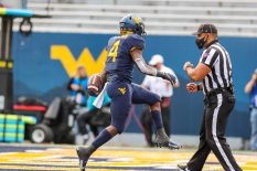 Oct 3, 2020; Morgantown, West Virginia, USA; West Virginia Mountaineers running back Leddie Brown (4) runs the ball for a touchdown to win the game during the second overtime against the Baylor Bears at Mountaineer Field at Milan Puskar Stadium. Mandatory Credit: Ben Queen-USA TODAY Sports