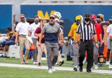 Sep 12, 2020; Morgantown, West Virginia, USA; West Virginia Mountaineers head coach Neal Brown yells along the sidelines during the third quarter against the Eastern Kentucky Colonels at Mountaineer Field at Milan Puskar Stadium. Mandatory Credit: Ben Queen-USA TODAY Sports