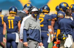 Oct 3, 2020; Morgantown, West Virginia, USA; West Virginia Mountaineers head coach Neal Brown walks along the sidelines during the first quarter against the Baylor Bears at Mountaineer Field at Milan Puskar Stadium. Mandatory Credit: Ben Queen-USA TODAY Sports