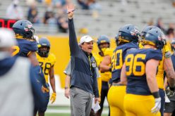 April 24, 2021; Morgantown, West Virginia, USA; West Virginia Mountaineers head coach Neal Brown yells out a fourth down call during the Spring Game at Mountaineer Field at Milan Puskar Stadium. Mandatory Credit: Ben Queen
