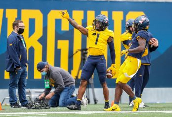 April 24, 2021; Morgantown, West Virginia, USA; West Virginia Mountaineers wide receiver Winston Wright (1) celebrates a first down during the Spring Game at Mountaineer Field at Milan Puskar Stadium. Mandatory Credit: Ben Queen