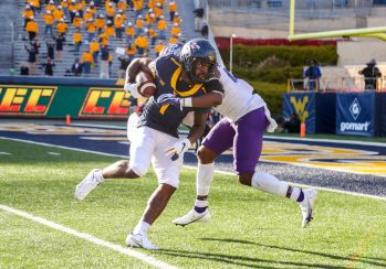 Nov 14, 2020; Morgantown, West Virginia, USA; West Virginia Mountaineers wide receiver T.J. Simmons (1) catches a pass and runs for a touchdown during the fourth quarter against the TCU Horned Frogs at Mountaineer Field at Milan Puskar Stadium. Mandatory Credit: Ben Queen-USA TODAY Sports