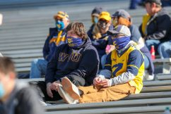 Oct 17, 2020; Morgantown, West Virginia, USA; West Virginia Mountaineers fans watch warmups prior to the game against the Kansas Jayhawks at Mountaineer Field at Milan Puskar Stadium. Mandatory Credit: Ben Queen-USA TODAY Sports
