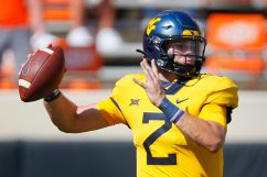 STILLWATER, OK - SEPTEMBER 26: Quarterback Jarret Doege #2 of the West Virginia Mountaineers throws against the Oklahoma State Cowboys in the first quarter on September 26, 2020 at Boone Pickens Stadium in Stillwater, Oklahoma. (Pool Photo by Brian Bahr/Getty Images) EDITORIAL USE ONLY *** Local Caption *** Jarret Doege