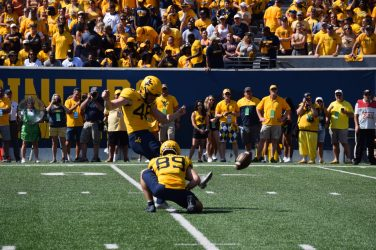 Casey Legg, 48, hits a field goal for the Moutnaineers. Fans cheer on the Mountaineers. (WVSN photo by Kelsie LeRose)