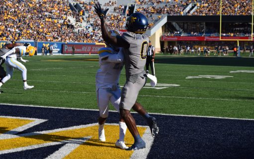 Wide receiver Bryce Ford-Wheaton goes up for a pass.