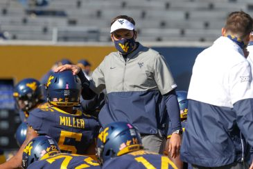 MORGANTOWN, WV - OCTOBER 17: West Virginia Mountaineers head coach Neal Brown encourages West Virginia Mountaineers cornerback Dreshun Miller (5) as he walks among his players prior to the college football game between the Kansas Jayhawks and the West Virginia Mountaineers on October 17, 2020, at Mountaineer Field at Milan Puskar Stadium in Morgantown, WV. (Photo by Frank Jansky/Icon Sportswire)