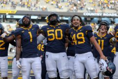 MORGANTOWN, WV - NOVEMBER 14: West Virginia Mountaineers wide receiver T.J. Simmons (1), West Virginia Mountaineers offensive lineman Brandon Yates (50) and West Virginia Mountaineers punter Evan Matthes (49) celebrate as they sing Country Roads following the college football game between the TCU Horned Frogs and the West Virginia Mountaineers on November 14, 2020, at Mountaineer Field at Milan Puskar Stadium in Morgantown, WV. (Photo by Frank Jansky/Icon Sportswire)