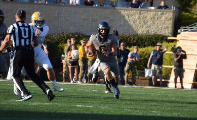 Garrett Greene runs the football Saturday evening against LIU. (WVSN photo by Kelsie LeRose)